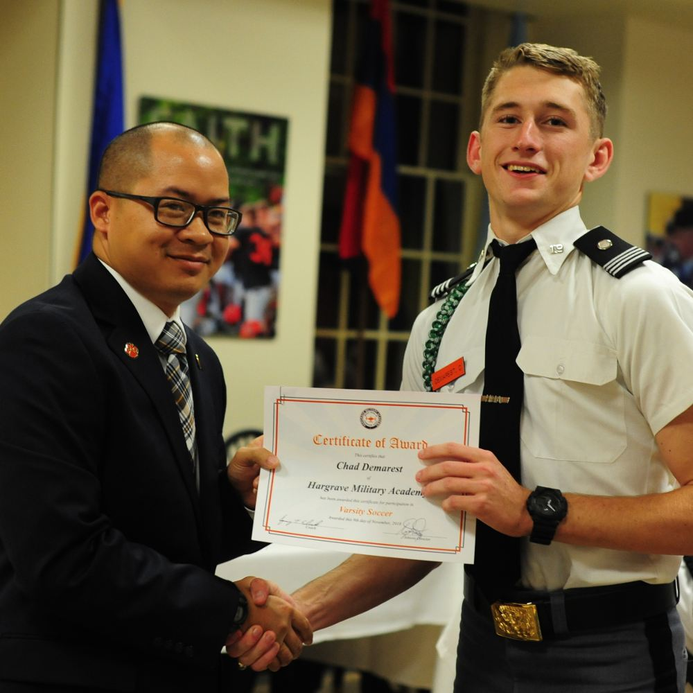 Cadet being presented with award