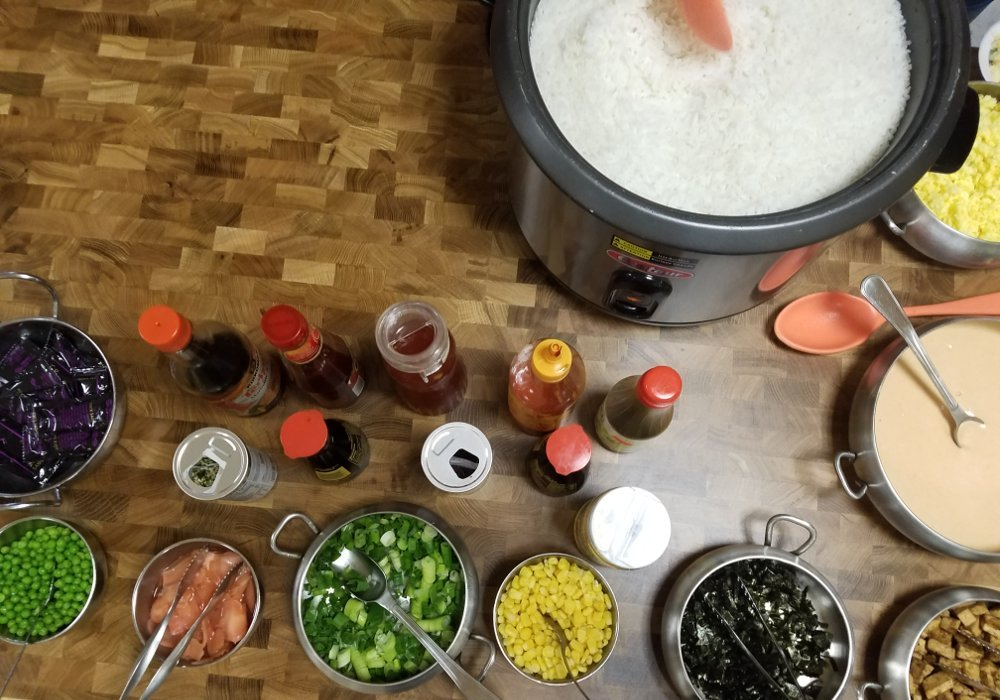 Pot of rice, vegetables, condiments, etc.
