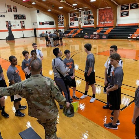 Cadets meeting on the basketball court