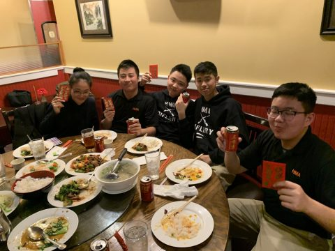 Cadets and chaperone at dinner