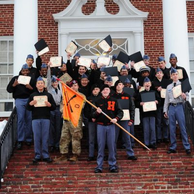 Delta company on steps after graduation